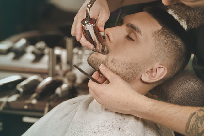 Man Getting Beard Trimmed