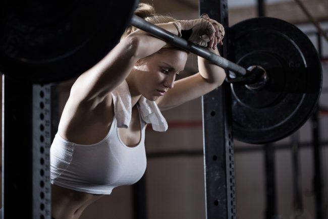 female tired with weights