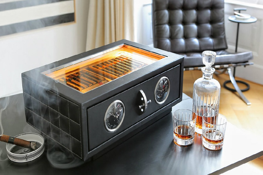 humidor with cigars and bottle of cognac